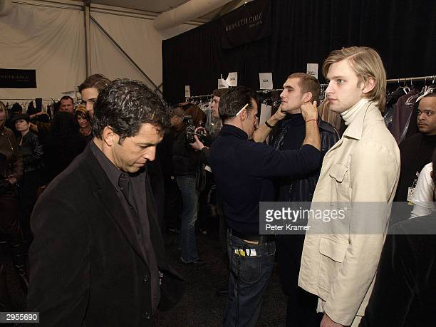 Designer Kenneth Cole prepares models backstage at the Kenneth Cole fashion show during Olympus Fashion Week at Bryant Park February 6 2004 in New...