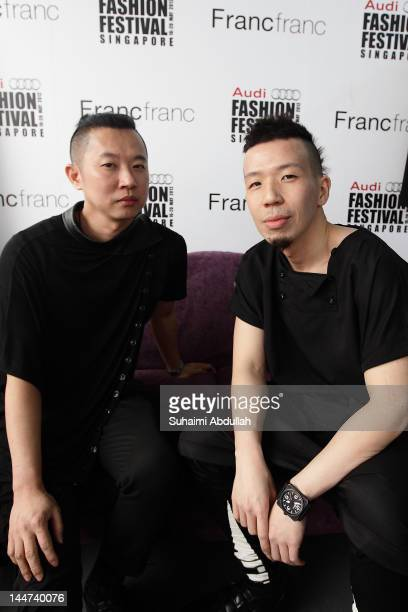 Designer Kenny Lim and Andrew Loh of fashion label Depression poses backstage before the Singapore Designer Showcase catwalk event at the...