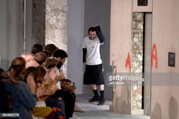 Designer Kiko Kostadinov appears on the runway following the Kiko Kostadinov Presentation during the London Fashion Week Men's June 2017 collections...
