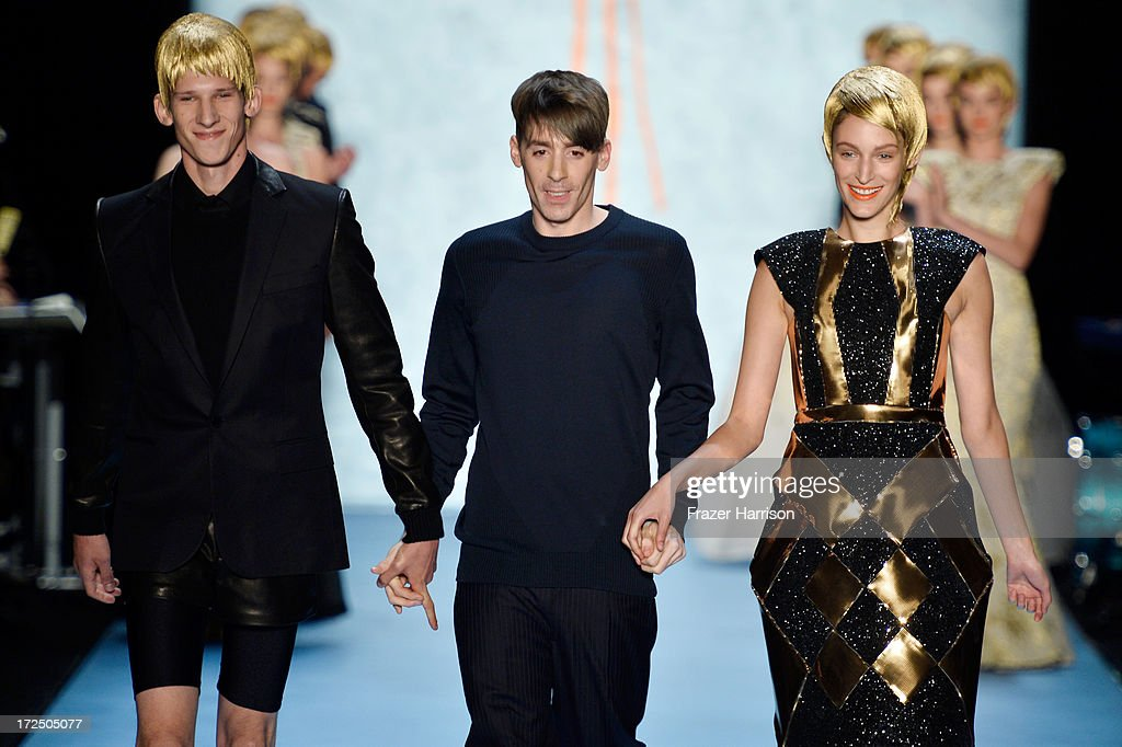 Designer Kilian Kerner (C) and his models at the end of the Kilian Kerner Show during Mercedes-Benz Fashion Week Spring/Summer 2014 at Brandenburg Gate on July 2, 2013 in Berlin, Germany.