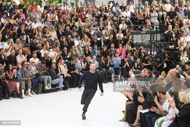 Designer Kim Jones walks the runway during the finale of the Dior Homme Menswear Spring/Summer 2019 show as part of Paris Fashion Week on June 23...