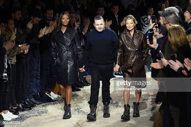Designer Kim Jones walks the runway with Naomi Campbell and Kate Moss during the Louis Vuitton Menswear Fall/Winter 20182019 show finale as part of...