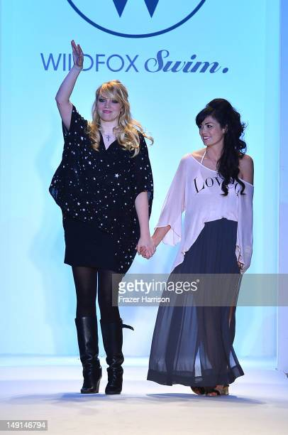 Designer Kimberley Gordon and a model walk the runway at the Wildfox Swim show during MercedesBenz Fashion Week Swim 2013 at The Raleigh on July 23...