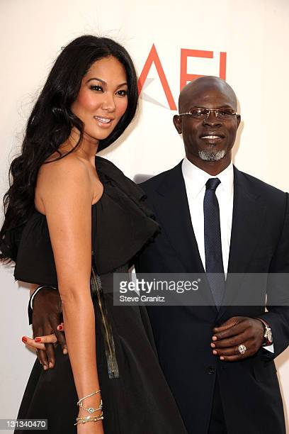 Designer Kimora Lee and actor Djimon Hounsou arrives at AFI's 39th Annual Achievement Award Honoring Morgan Freeman at Sony Pictures Studios on June...
