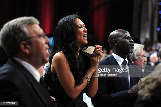 Designer Kimora Lee and actor Djimon Hounsou pose in the audience at the 39th AFI Life Achievement Award honoring Morgan Freeman held at Sony...