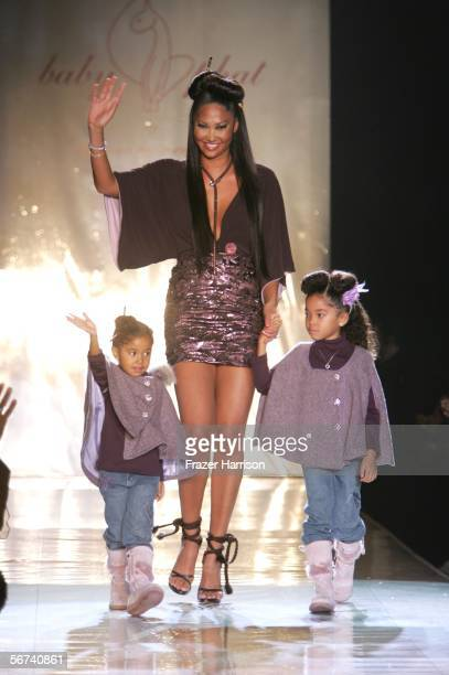 Designer Kimora Lee Simmons and her daughters walk the runway at the Baby Phat Fall 2006 fashion show during Olympus Fashion Week at Bryant Park...