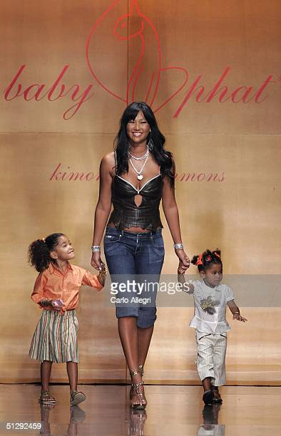 Designer Kimora Lee Simmons and her two daughters walk the runway at the Baby Phat Spring 2005 fashion show held at Sky Light Gallery during the...
