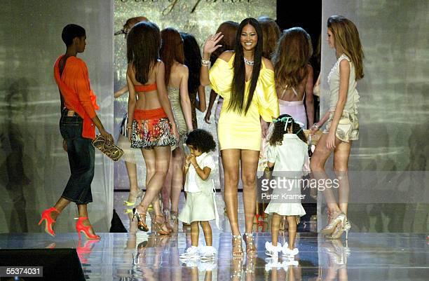 Designer Kimora Lee Simmons and models walks the runway at the Baby Phat Spring 2006 fashion show during Olympus Fashion Week at Radio City Music...