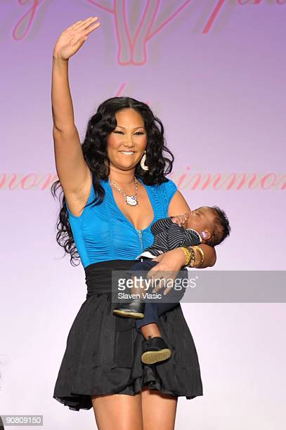 Designer Kimora Lee Simmons and son Kenzo Lee Hounsou on the runway at the Baby Phat KLS Collection Spring 2010 fashion show at Roseland Ballroom on...