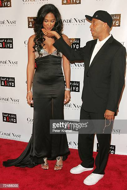 Designer Kimora Lee Simmons removes her chewing gum into the hand of Recording executive/producer Russell Simmons at 'The Black Ball' presented by...