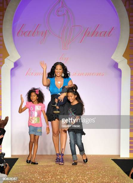 Designer Kimora Lee Simmons walks the runway with her children at the Baby Phat KLS Collection Spring 2010 fashion show at Roseland Ballroom on...