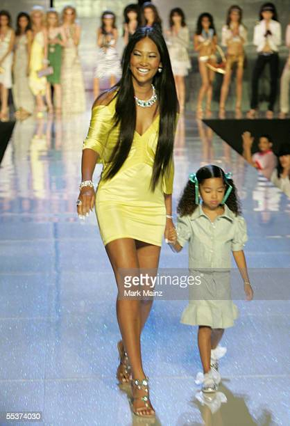 Designer Kimora Lee Simmons walks up the runway with her model daughter Ming Lee Simmons at the Baby Phat Spring 2006 fashion show during Olympus...