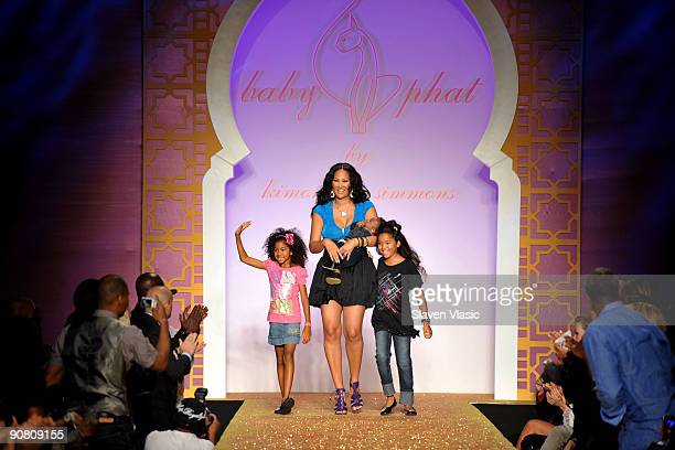 Designer Kimora Lee Simmons with children Aoki Lee Kenzo Lee Hounsou and Ming Lee on the runway at the Baby Phat KLS Collection Spring 2010 fashion...