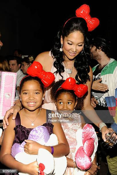 Designer Kimora Lee with daughters Ming Lee Simmons and Aoki Lee Simmons arrive at the Hello Kitty 35th anniversary celebration held at Royal/T on...