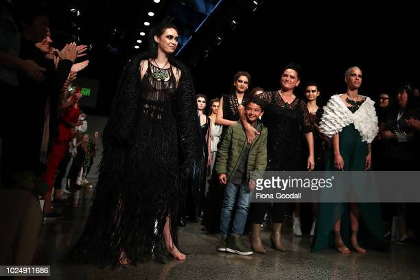 Designer Kiri Nathan joins models on the runway during the Kiri Nathan show during New Zealand Fashion Week 2018 at Viaduct Events Centreâ on August...