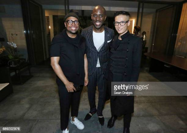 Designer Kirk Pickersgill SAINT International CEO Dwight Peters and Stephen Wong of Greta Constantine pose during the opening reception of StyleWeek...