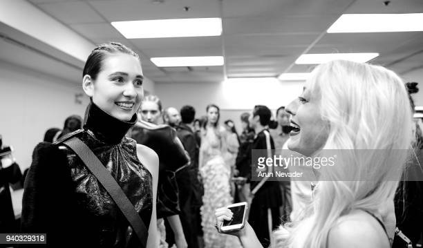 Designer Kirsten Ley is seen backstage with a model at Vancouver Fashion Week at Angel Orensanz Foundation on March 25 2018 in Vancouver Canada