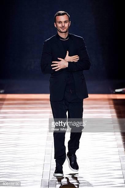 Designer Kris van Assche walks the runway during the Dior Homme Menswear Fall/Winter 20162017 show as part of Paris Fashion Week on January 23 2016...