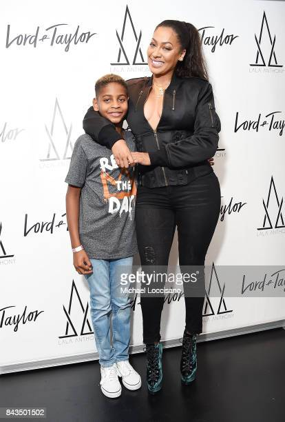Designer La La Anthony poses with her son Kiyan Carmelo Anthony during the launch of the 'La La Anthony Denim Collection' at Lord Taylor on September...