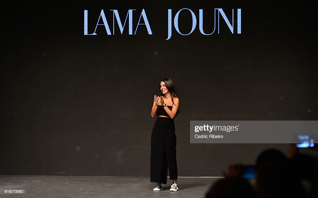 Designer Lama Jouni poses on the runway after her show during Fashion Forward Spring/Summer 2017 held at the Dubai Design District on October 22, 2016 in Dubai, United Arab Emirates.