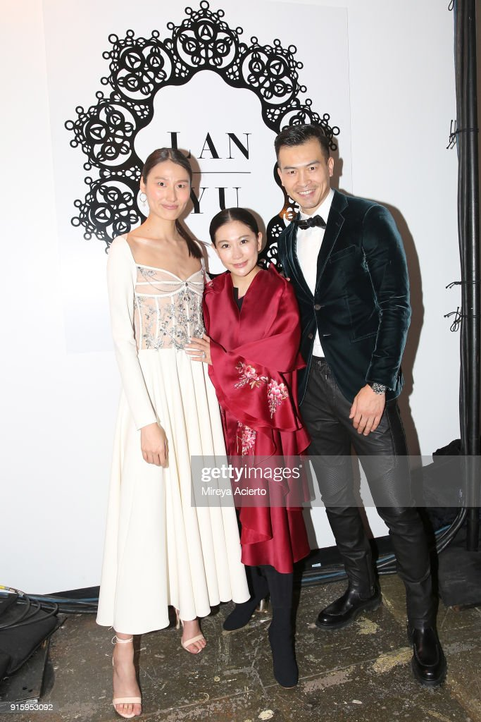 Designer Lan Yu and a guests pose backstage for Lanyu during New York Fashion Week: The Shows at Industria Studios on February 8, 2018 in New York City.