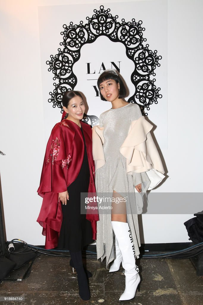 Designer Lan Yu and influencer Michelle Song pose backstage for Lanyu during New York Fashion Week: The Shows at Industria Studios on February 8, 2018 in New York City.