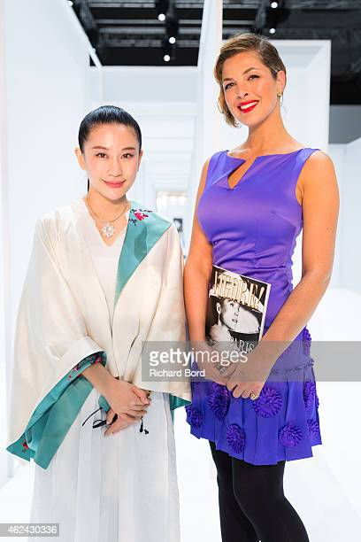 Designer Lan Yu and journalist Eleonore Boccara attend the Lan Yu show as part of the Paris Fashion Week Haute Couture Spring/Summer 2015 at the...