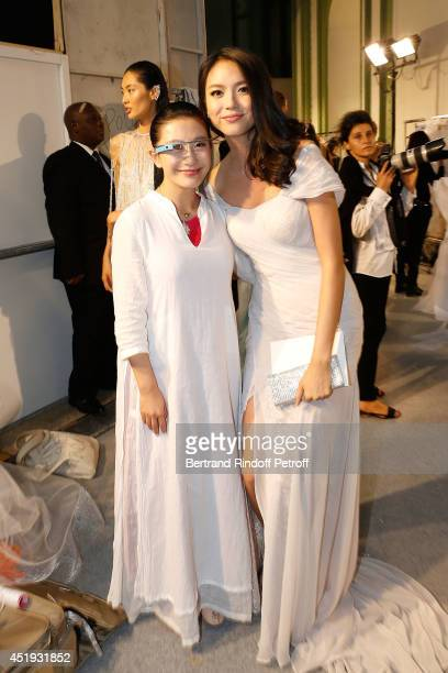 Designer Lan Yu and Miss World 2007 Zhang Zilin attend the Lan Yu show as part of Paris Fashion Week Haute Couture Fall/Winter 20142015 at the Grand...