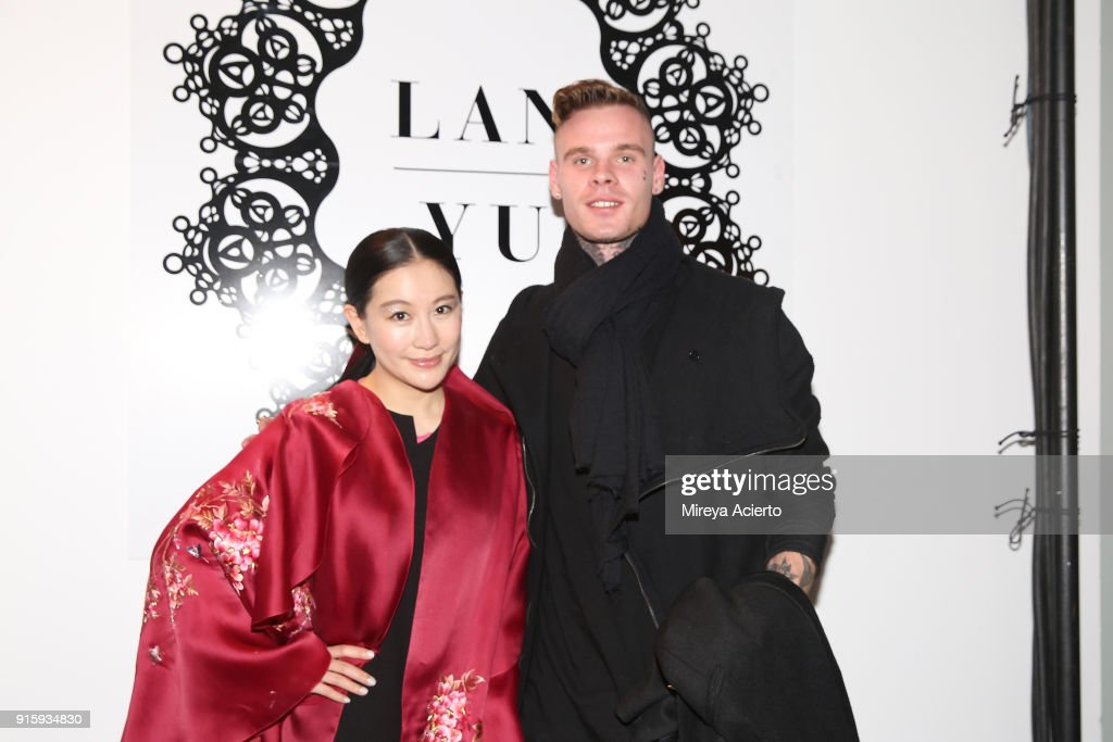 Designer Lan Yu and recording artist Russian Roulette pose backstage for Lanyu during New York Fashion Week: The Shows at Industria Studios on February 8, 2018 in New York City.
