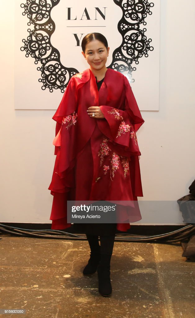 Designer Lan Yu poses backstage for Lanyu during New York Fashion Week: The Shows at Industria Studios on February 8, 2018 in New York City.