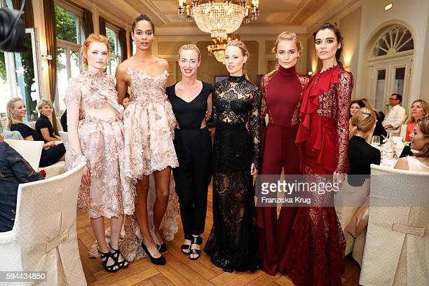 Designer Lana Mueller and her models pose for photographs during the Society Relations Ladies Lunch in favor of the Stiftung Deutsche...