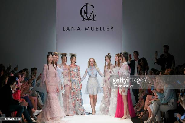 Designer Lana Mueller and Paulina Swarovski acknowledges the applause of the audience after the Lana Mueller show during the Berlin Fashion Week...