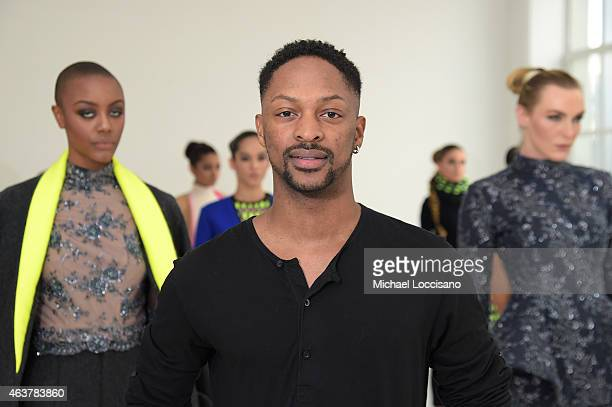 Designer Laquan Smith poses with models at the Laquan Smith Presentation during MercedesBenz Fashion Week Fall 2015 at Drift Studios on February 18...