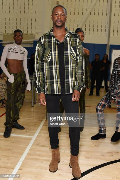 Designer Laquan Smith poses with models at the Laquan Smith presentation during New York Fashion Week on September 10 2017 in New York City