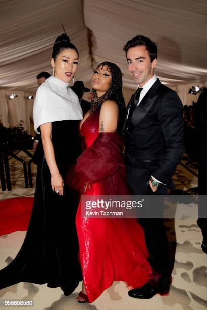 Designer Laura Kim recording artist Nicki Minaj and designer Fernando Garcia attend the Heavenly Bodies Fashion The Catholic Imagination Costume...