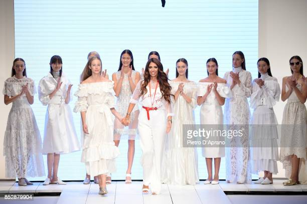 Designer Lavinia Biagiotti ackowledges the applause of the audience the Laura Biagiotti show during Milan Fashion Week Spring/Summer 2018 on...