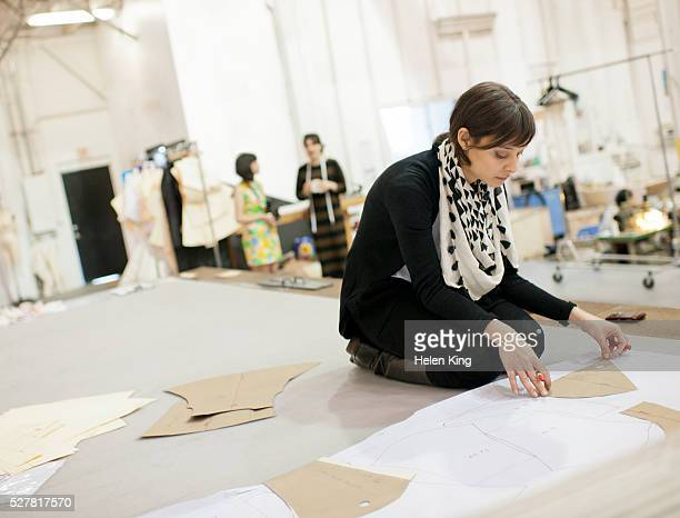 Designer lays out garment patterns for production