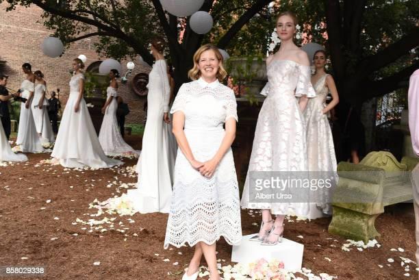 Designer Leal Rose poses with models at the Lela Rose Presentation during New York Fashion Week Bridal at Elizabeth Street Garden on October 5 2017...