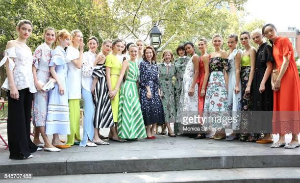 Designer Lela Rose and actress Ellie Kemper pose for a photo with models at the Lela Rose Presentation during New York Fashion Week at Washington...