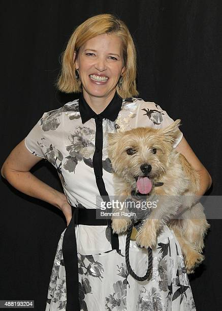 Designer Lela Rose poses for a picture on the backstage with dog Bobbin at the Lela Rose Fashion Show during Spring 2016at The Gallery Skylight at...