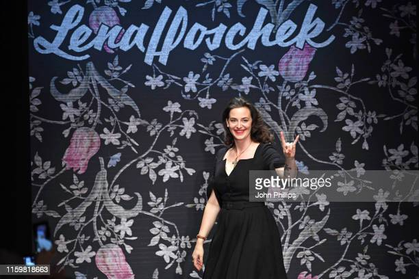 Designer Lena Hoschek acknowledges the applause of the audience after her show during the Berlin Fashion Week Spring/Summer 2020 at ewerk on July 03...