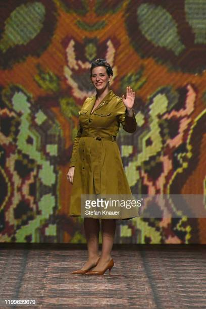 Designer Lena Hoschek acknowledges the applause of the audience after her show during Berlin Fashion Week Autumn/Winter 2020 at Kraftwerk Mitte on...