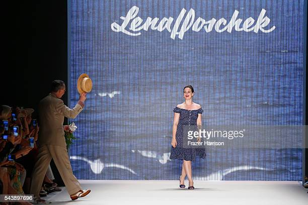 Designer Lena Hoschek gets flowers from Reinhard Maetzler after her show during the MercedesBenz Fashion Week Berlin Spring/Summer 2017 at Erika Hess...