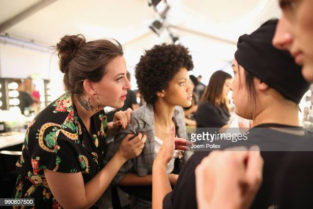 Designer Lena Hoschek prepares a model backstage ahead of her show during the Berlin Fashion Week Spring/Summer 2019 at ewerk on July 3 2018 in...