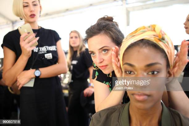 Designer Lena Hoschek prepares a model backstage ahead of her show during the Berlin Fashion Week Spring/Summer 2019 at ewerk on July 3 2018 in...