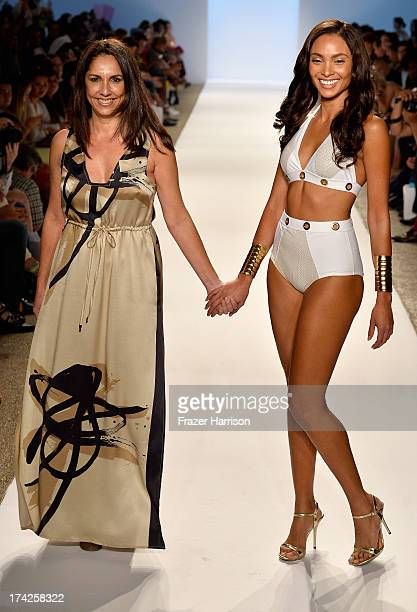 Designer Liliana Villalobos and a model walk the runway at the Aguaclara Swimwear show at Cabana Grande at the Raleigh on July 22 2013 in Miami...