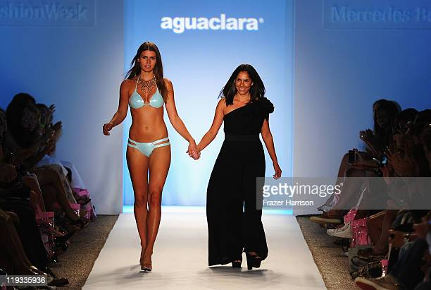 Designer Liliana Villalobos walks the runway with a model at the Aguaclara show during MerecedesBenz Fashion Week Swim 2012 on July 18 2011 in Miami...