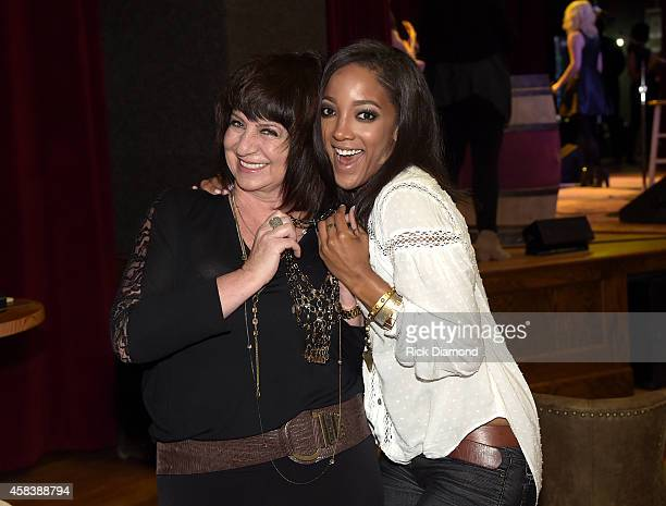 Designer Lisa George and Mickey Guyton attends the CMT Next Women Of Country at City Winery Nashville on November 4 2014 in Nashville Tennessee