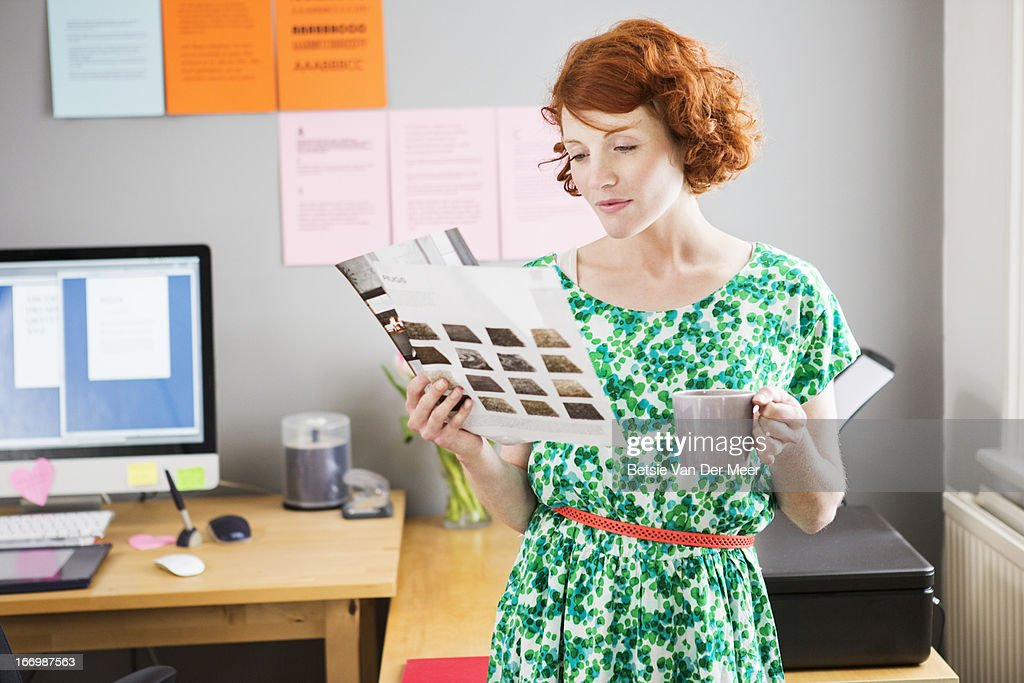 Designer looking at design in office. : Stock Photo
