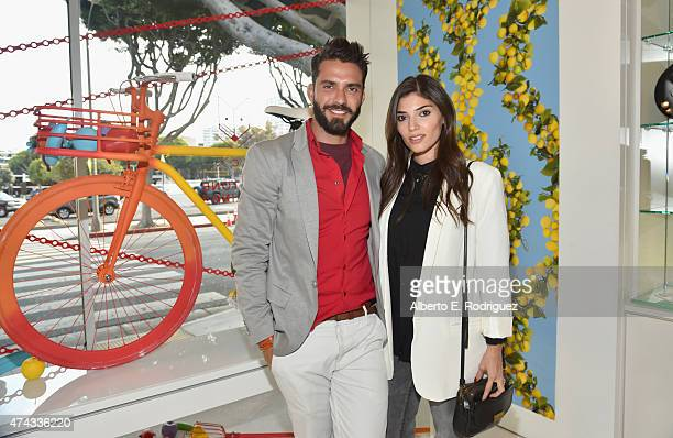 Designer Lorenzo Martone and actress Amanda Setton attend #UNCHAINMEAn Art Bike Show By Martone Cycling Co at Ron Robinson on May 21 2015 in Santa...